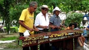 Three men playing a Marimba in Costa Rica
