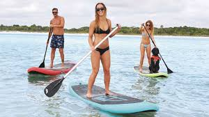 3 people paddleboarding