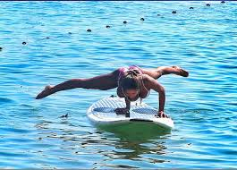 girl doing yoga on a paddleboard