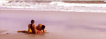 People enjoying Costa Rica's natural energy on the beach - the sun