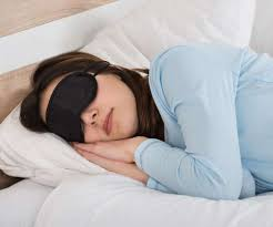 Woman sleeping with a mask on