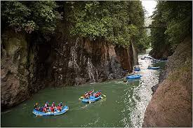 Groups of people rafting on the Corobici river in Costa Rica