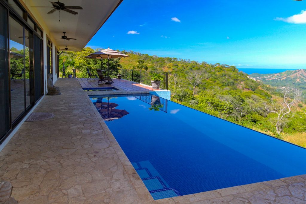View of the Pacific Ocean across an infinity edge pool in Costa Rica
